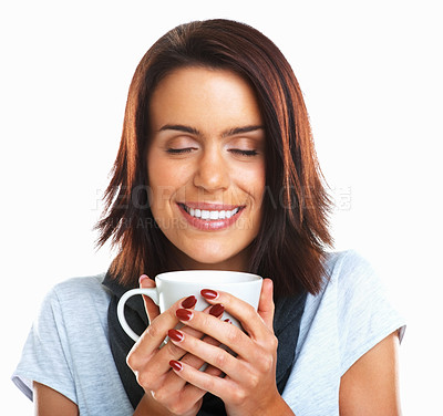 Buy stock photo Young attractive brunette girl enjoys a cup of fragrant coffee against white background