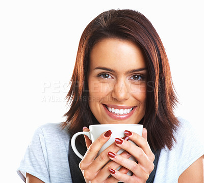 Buy stock photo Closeup portrait of an attractive female holding coffee cup and smiling against white background