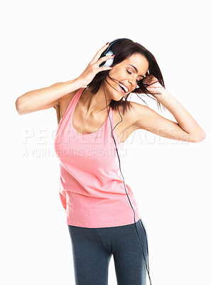 Buy stock photo Young mixed race woman dancing to music with headphones against white background