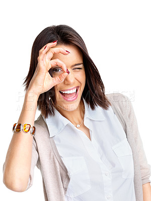 Buy stock photo Portrait of a happy young woman doing okay sign against white background