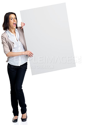 Buy stock photo Full length portrait of an excited young woman holding an empty bill board over white background
