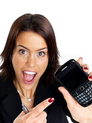 Buy stock photo Portrait of a surprised young businesswoman pointing at new mobile phone against white background