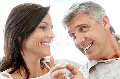 Buy stock photo Portrait of a romantic middle aged couple relaxing together against white