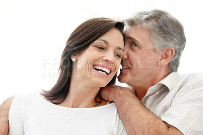 Buy stock photo Portrait of a happy mature man sharing some secret with her wife