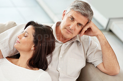 Buy stock photo Portrait of a mature man sitting  with his wife sleeping on couch at home