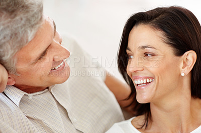 Buy stock photo Happy mature couple looking at each other and smiling