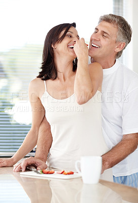 Buy stock photo Portrait of happy mature couple eating fruits together