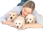 Cute puppies and young girl hugging