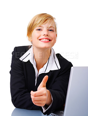 Buy stock photo Portrait of an adorable business woman sitting by a desk and laptop, giving thumbs up. This isolate is taken in our studio.