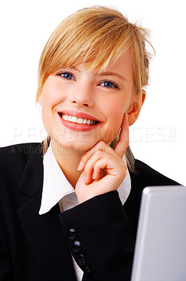 Buy stock photo Portrait of an adorable business woman sitting by a desk and laptop. This isolate is taken in our studio.