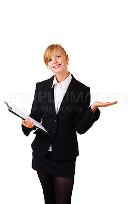Buy stock photo Beautiful business woman holding her hand out flat as if presenting a product. Ready for you to add txt or graphics. This isolate was taken in out studio.