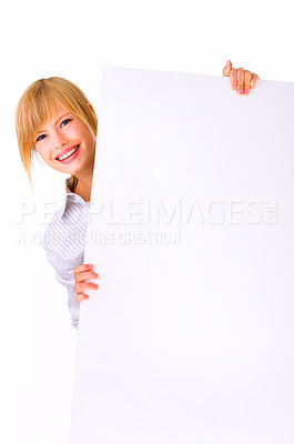 Buy stock photo Female holding sign or board - Portrait of a beautiful woman holding a blank billboard.