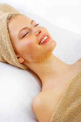 Buy stock photo Shot of a young woman relaxing at a spa