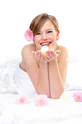 Buy stock photo Young woman holding rose petals, smiling, looking up
