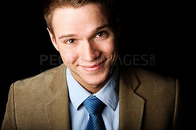 Buy stock photo Portrait of a happy young business man isolated on black.
