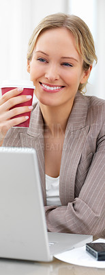 Buy stock photo Portrait of a young beautiful woman working on computer and drinking coffee