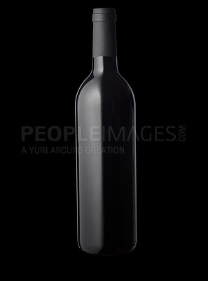 Buy stock photo Isolated red wine bottle on black background.