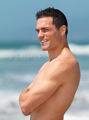 Buy stock photo Side view of a happy young man with arms crossed