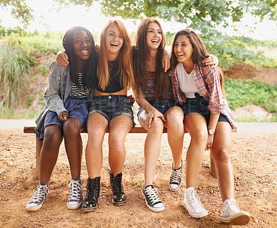 Buy stock photo A group of friends laughing happily as they spend time outdoors in the sun