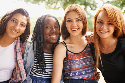 Buy stock photo Four beautiful young girls smiling happinly while they sit outside