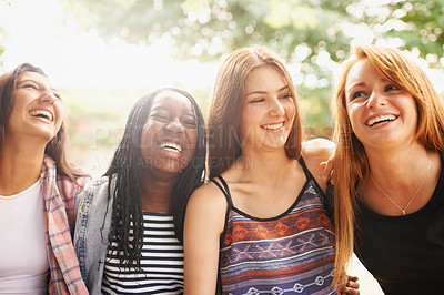 Buy stock photo A cropped shot of four laughing girls sitting outdoors