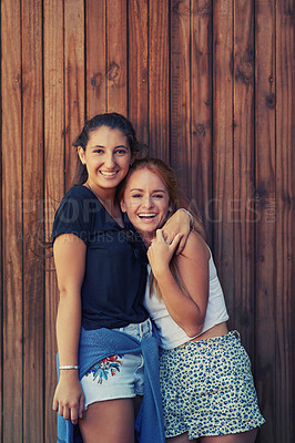Buy stock photo To young girls holding each other affectionately