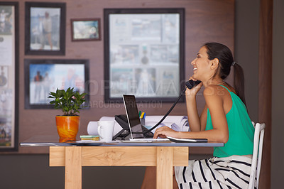 Buy stock photo A young woman chatting happily on her telephone