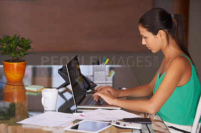 Buy stock photo A young woman hard at work sitting in her home office