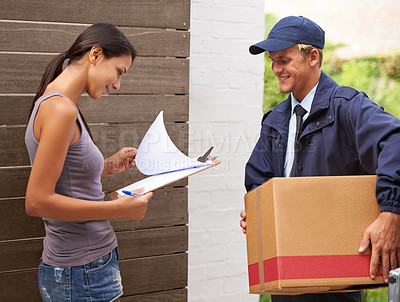 Buy stock photo Cropped shot of a beautiful woman receiving a delivery
