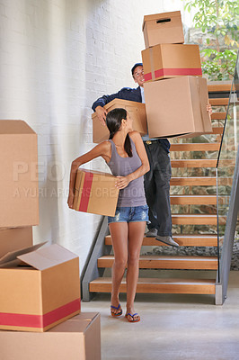 Buy stock photo Full length shot of a delivery man helping a gorgeous brunette with her boxes
