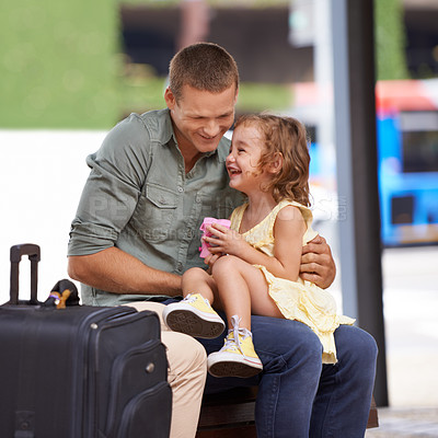 Buy stock photo A father and daughter having fun together while waiting for their bus