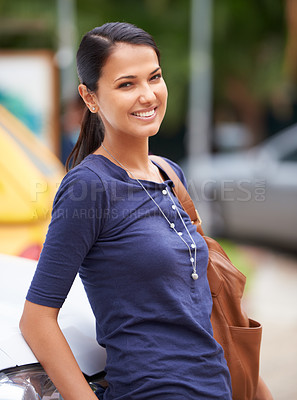 Buy stock photo A beautiful woman leaning against her car outdoors