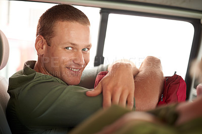 Buy stock photo A portrait of a happy man riding in a car