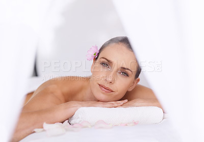 Buy stock photo Portrait of a gorgeous young woman lying on a massage table