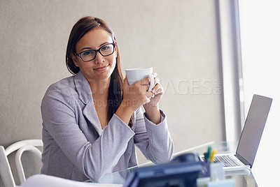 Buy stock photo An attractive young businesswoman drinking coffee while sitting at her desk