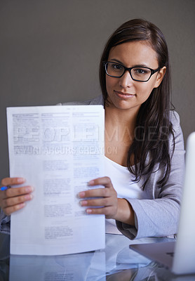 Buy stock photo Portrait of an attractive young businesswoman holding paperwork in her hands