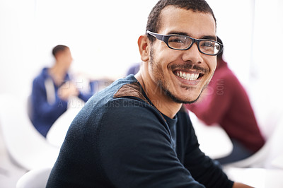 Buy stock photo Cropped shot of a young man sitting indoors