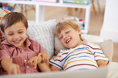 Buy stock photo Two boys watching stories on a laptop