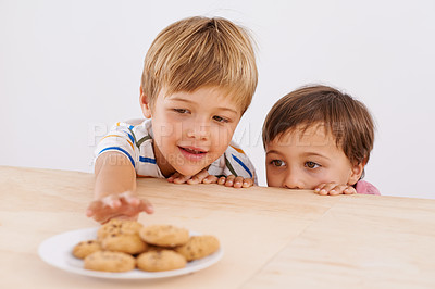 Buy stock photo Two adorable young boys peeking out of a cardboard box