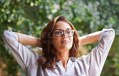 Buy stock photo Cropped shot of an attractive young woman relaxing outdoors