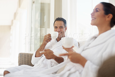 Buy stock photo Shot of a couple enjoying a cup of tea at a day spa