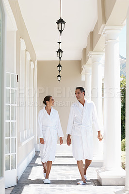 Buy stock photo Full-length shot of a couple walking together at a day spa