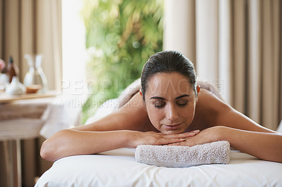 Buy stock photo Shot of an attractive woman resting on a massage table