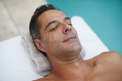 Buy stock photo Cropped shot of a handsome mature man enjoying a massage at a spa