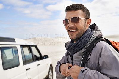 Buy stock photo Portrait of a handsome young hiker getting his gear together for the journey