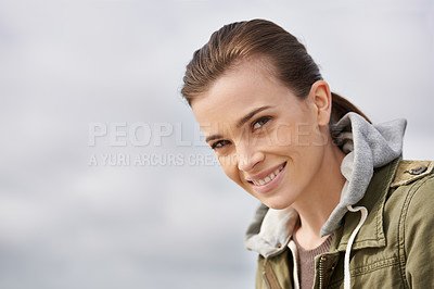 Buy stock photo Portrait of an attractive young woman enjoying the outdoors