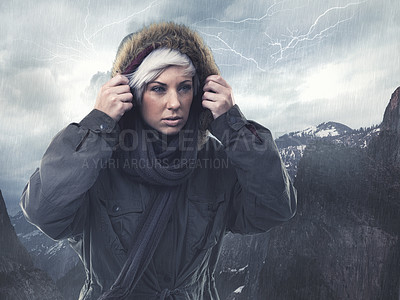Buy stock photo Cropped shot of an attractive young woman hiking in the midst of a snow storm