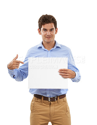 Buy stock photo Portrait of a handsome young man in a studio holding up a sign board and pointing to it
