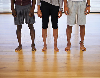 Buy stock photo Cropped shot of three unrecognizable people standing together in a dance studio