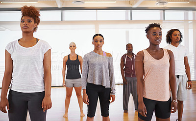 Buy stock photo Shot of a group of young dancers standing together in a studio